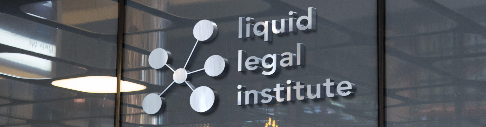photo of iron company logo of liquid legal institute on a wall