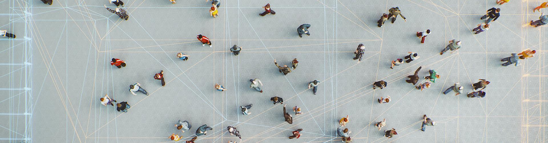 People walking across a large open space