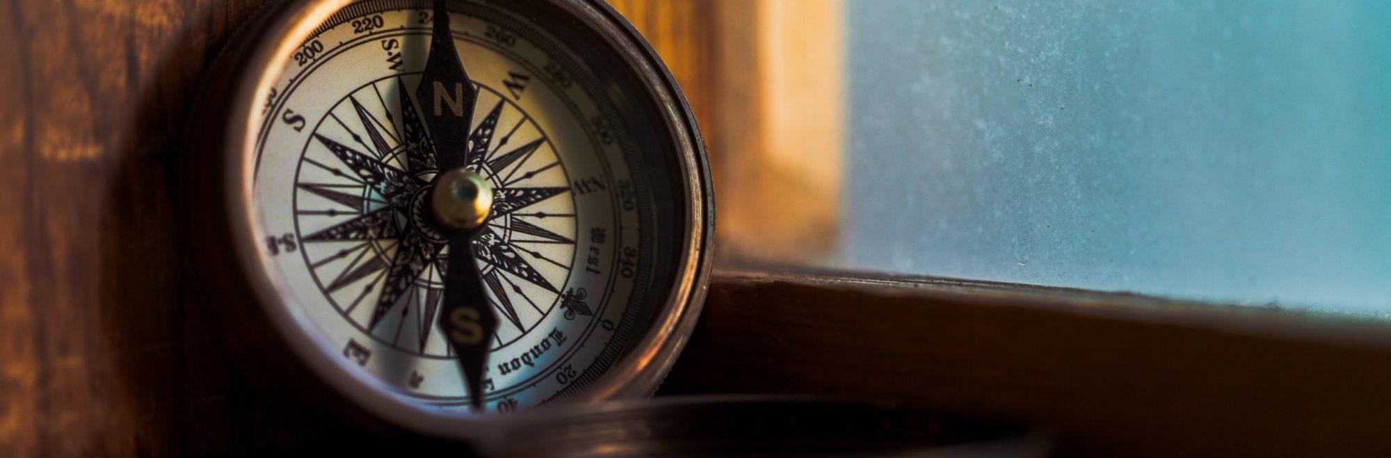 small, old looking compass ©Jordan Madrid, unsplash.com